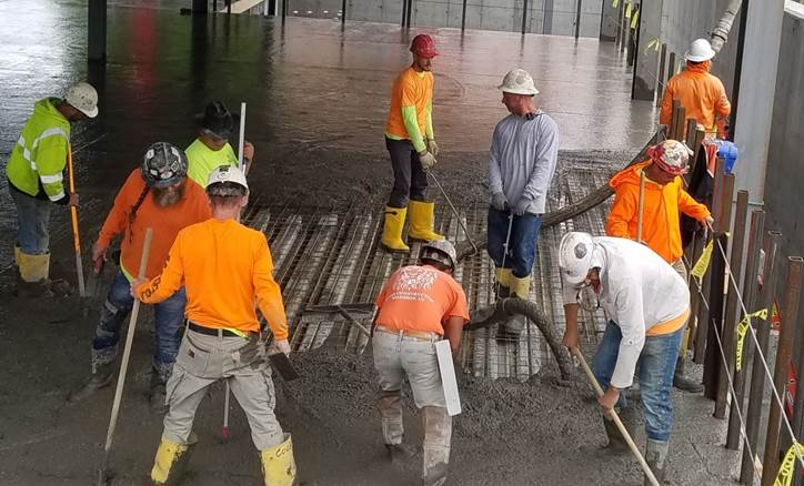 Concrete is poured to make floors