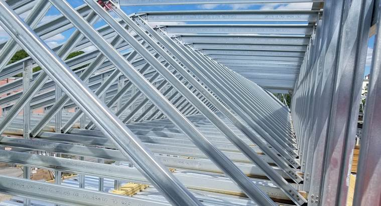 Angled metal roof trusses