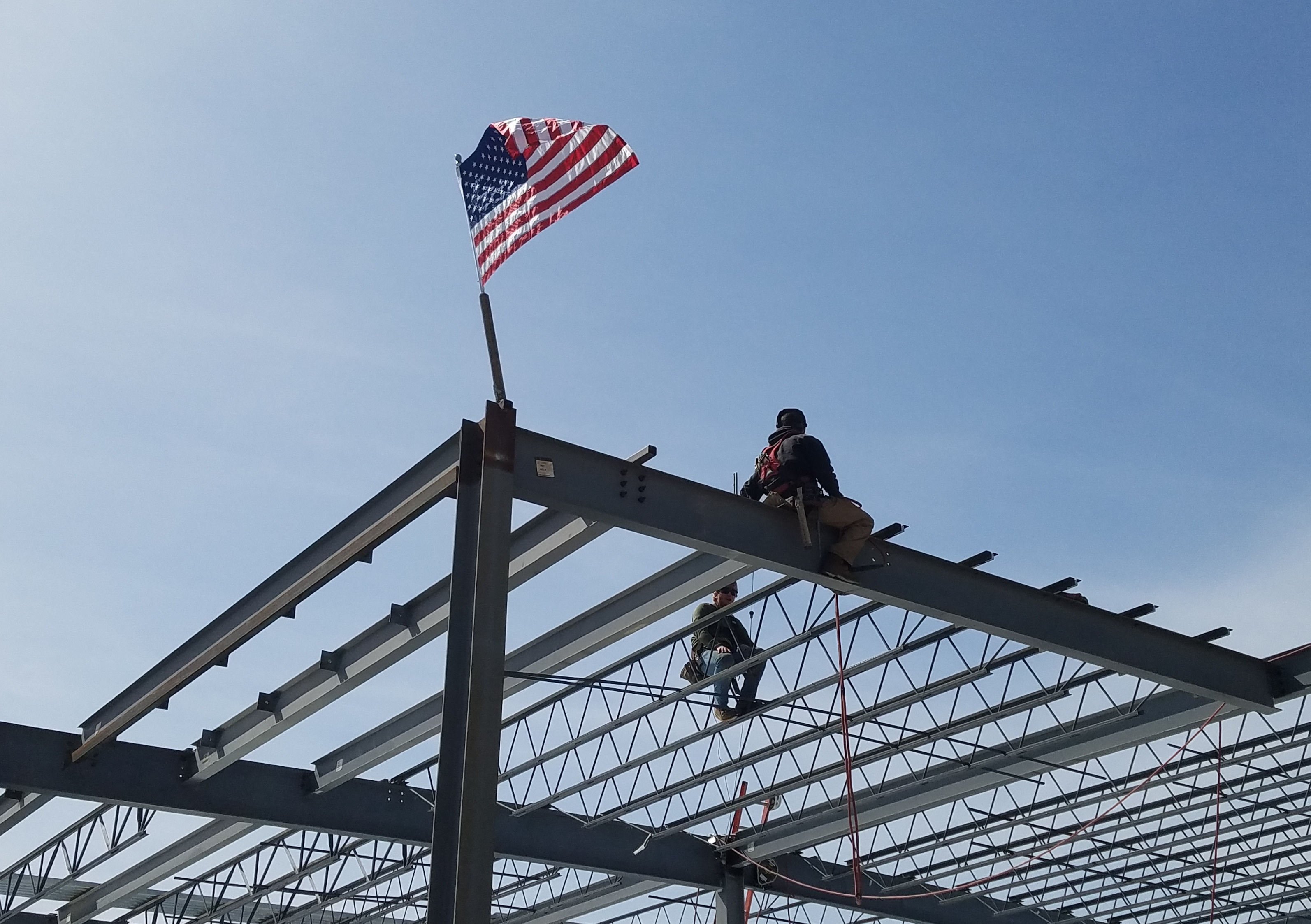 Flag topping off on steel beams